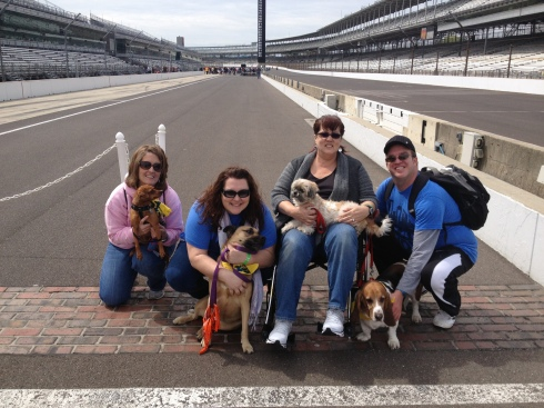 I love Mutt Strutt. This was my third year to walk in the fun on the most famous race track in the world. Posing at the Brickyard.